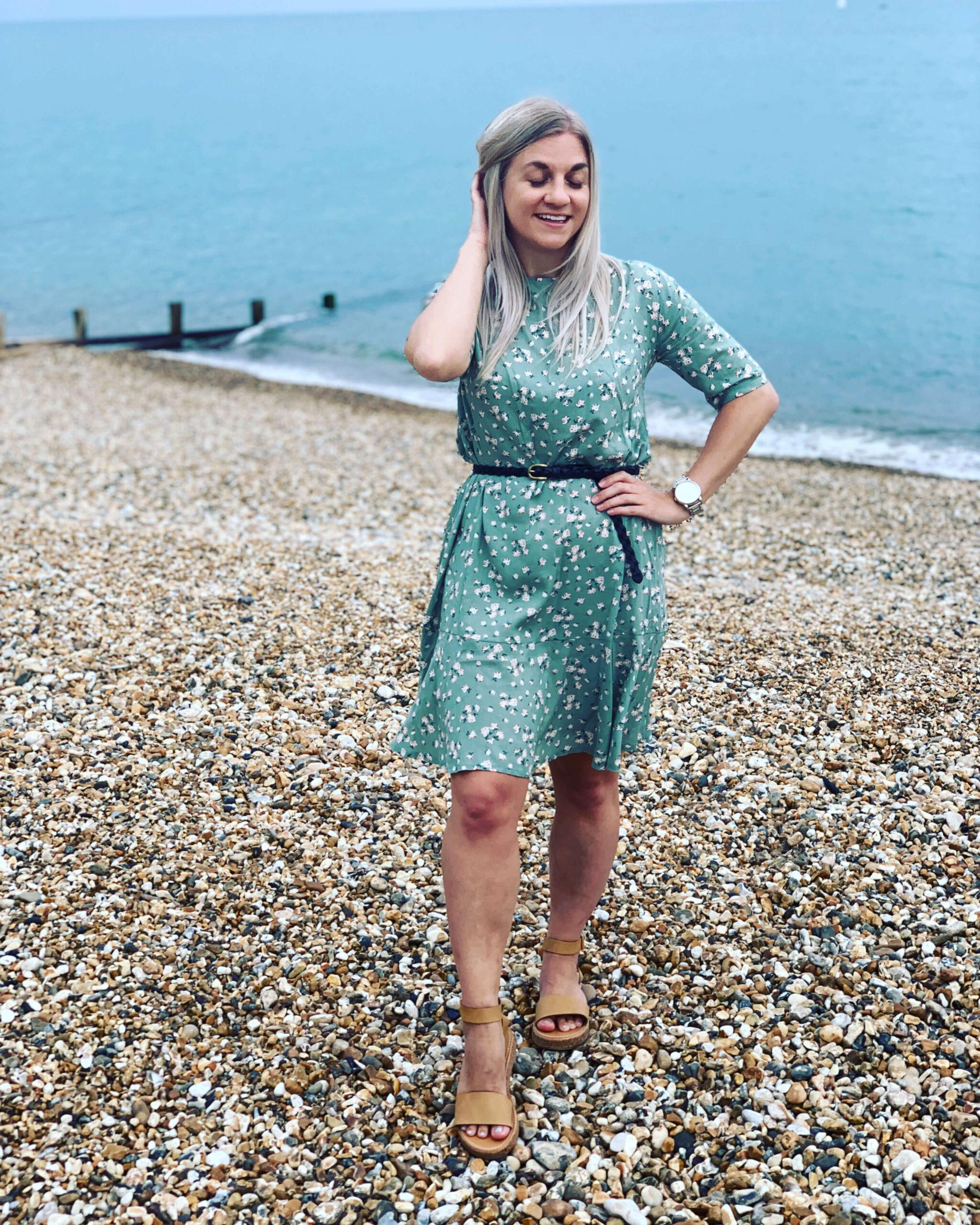 Woman on the beach wearing Dressfield dress