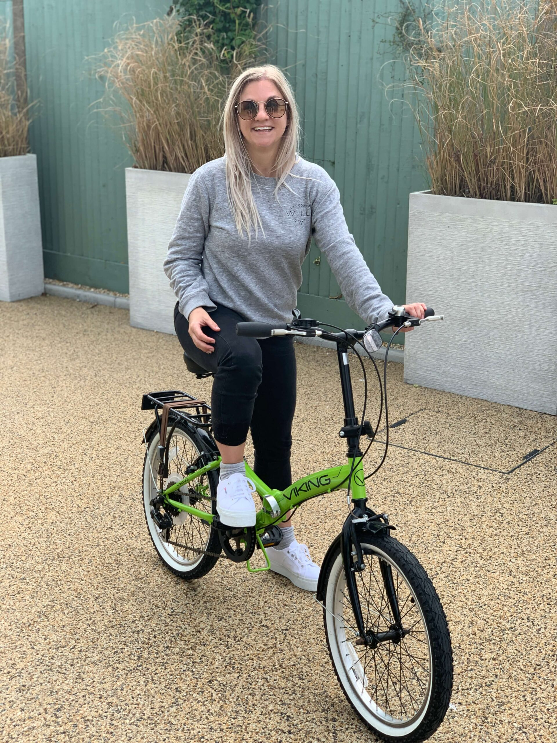 Woman sitting on a bike